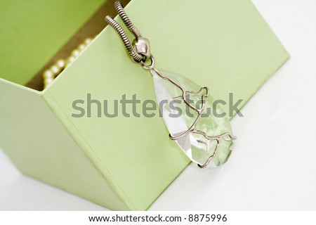 green gift box with diamond  necklace - stock photo
