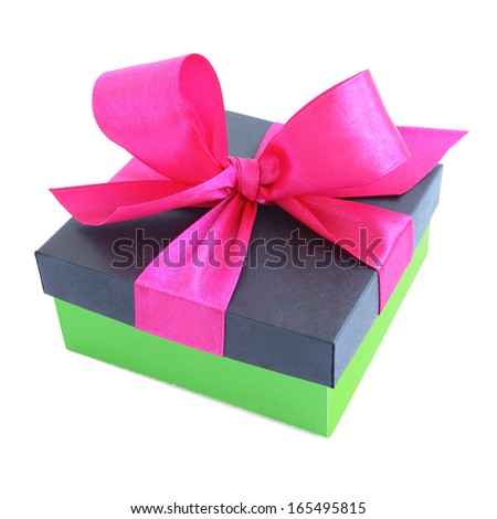 Green gift box with pink satin ribbon bow isolated on white