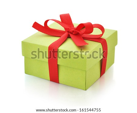 Green gift box with red ribbon isolated on white background.  - stock photo