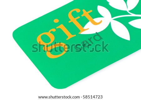 Green gift card with orange text and white leaves, great for environmentally friendly giving - stock photo