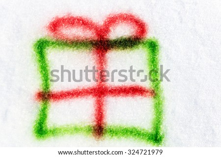 green gift sprayed with a aerosol can in the snow, concept christmas presents - stock photo