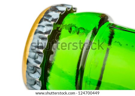 Green glass beer bottle with metal cap. - stock photo