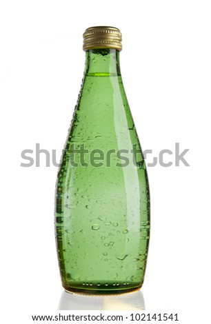 Green Glass bottle of soda water. Isolated on white background - stock photo