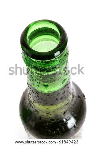 Green glass bottle with beer isolated on white - stock photo