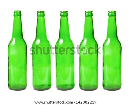 Green glass bottles in a row on a white background