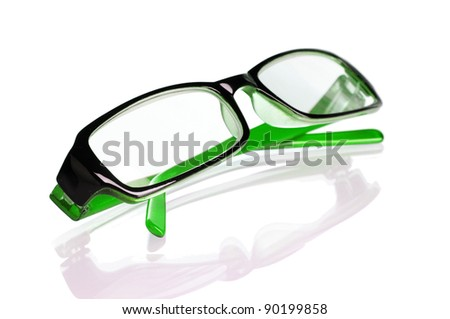 Green glasses isolated on white - stock photo