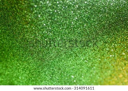 Green glitter bright shiny sparkle background. Green glitter texture for background. Element of design. - stock photo