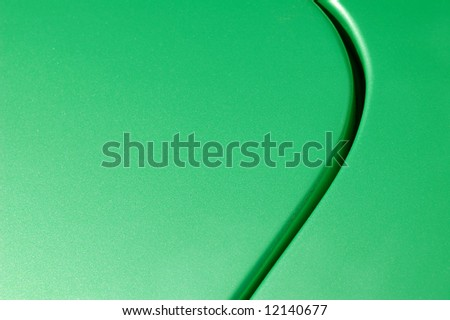 green glittered vehicle panel abstract - stock photo