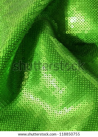 Green, glittering disco sequins background. More of this motif and more textiles in my port. - stock photo