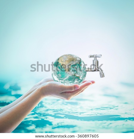 Green globe in woman human hand w/ water tab & blur natural blue aqua ocean background: World environmental protection concept: Saving water conceptual idea: Elements of this image furnished by NASA - stock photo