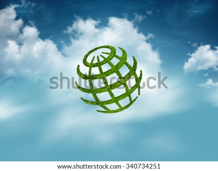Green globe on sky with cloud background, environmental concept - stock photo