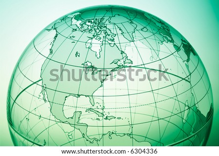 Green globe with backlit light - stock photo