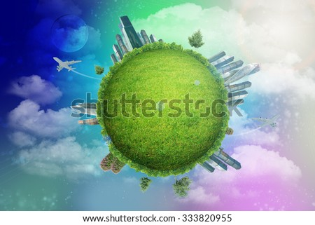 Green globe with city on colorful background with clouds