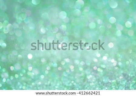 Green glow glitter background. Elegant abstract background with bokeh  - stock photo