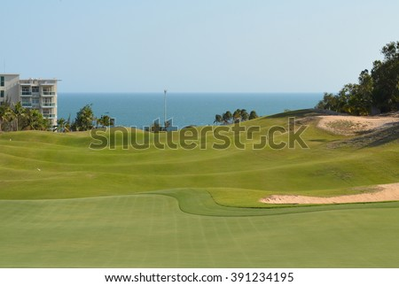 Green Golf Field Viewing The Sea with Palm Trees, Vietnam, Asia Pacific