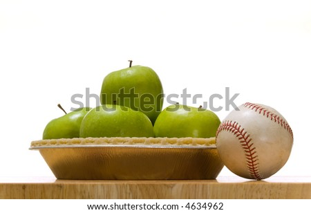 Green granny smith apple in a pie crust next to a baseball, symbols of American Summer, Baseball and apple pie - stock photo