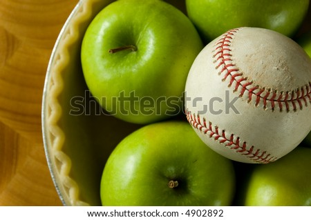 Green granny smith apple in a pie crust with a a baseball, symbols of American Summer, Baseball and apple pie - stock photo