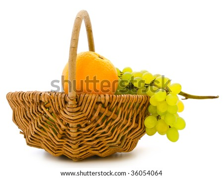 green grape and orange in basket against the white background