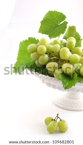 Green grape in vase isolated on white