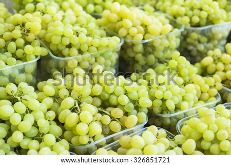 Green grapes at a farmers market (selective focus) - stock photo