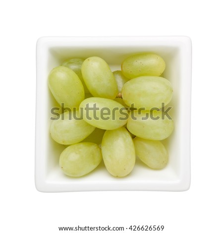 Green grapes in a square bowl isolated on white background