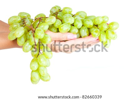 Green grapes in her hand. Isolation - stock photo