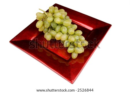 green grapes on a red plate, clipping path included