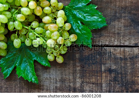 Green grapes on a rustic wooden table