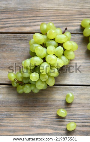 Green grapes on wooden boards, top view - stock photo