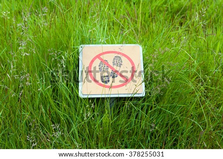 Green grass and a sign do not step. Iceland. - stock photo