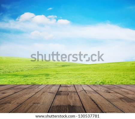 green grass, blue sky and wooden floor - stock photo