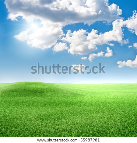 green grass, blue sky with clouds - stock photo
