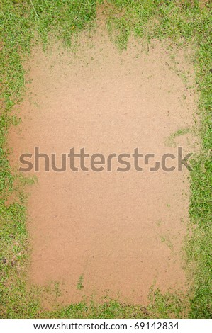 Green grass covered old paper texture with space for text