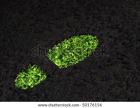 Green grass growing footprint on black asphalt