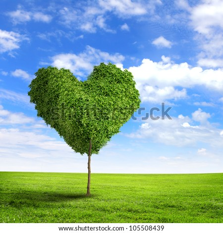 Green grass heart symbol against blue sky - stock photo