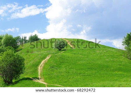 Green grass hill - stock photo