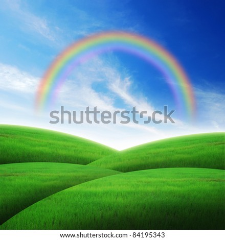Green grass landscape blue sky for Backgrounds and design rainbow - stock photo