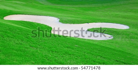 Green grass of the golf course - stock photo