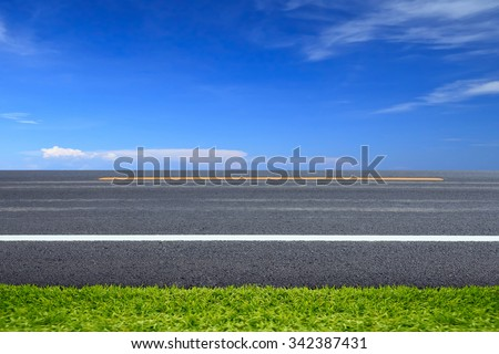Green grass on road. - stock photo