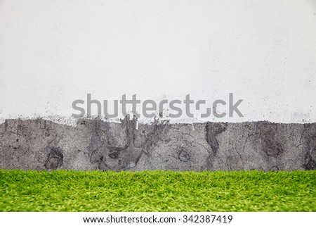 Green grass over brick wall background  - stock photo