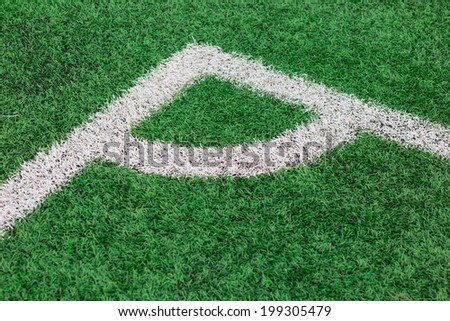 Green Grass texture of soccer or football field corner - stock photo
