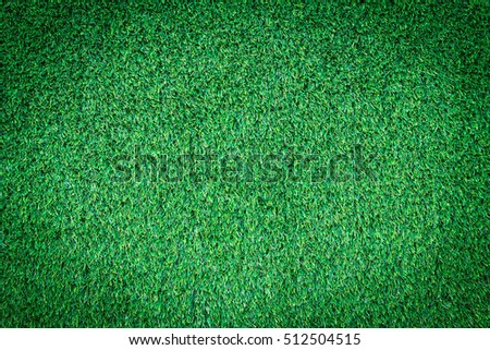 Green grass texture or Green grass background. Top view of artificial green grass for golf course and soccer field. Abstract artificial green grass. Dark edged.