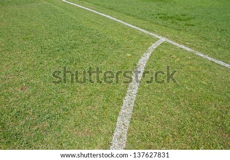 Green grass white line football pitch - stock photo