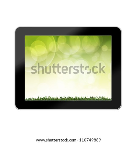 Green grass with background colorful in tablet Computer - stock photo