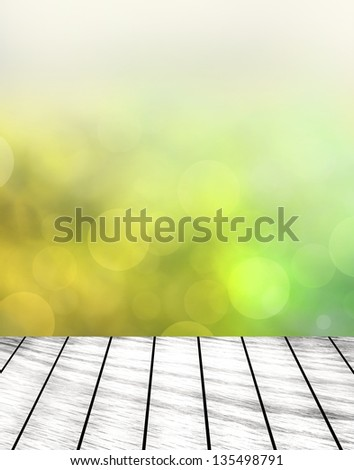 green grass with green bokeh and sunlight and wood floor - stock photo