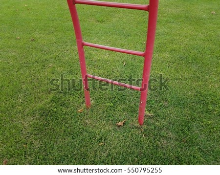 green grass with red ladder