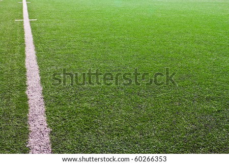 green grass with white line of football field - stock photo