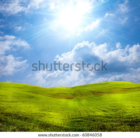 Green grassland with cloudy sky