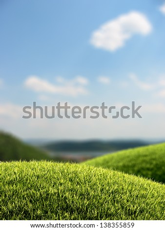 Green grassy hills with out-of-focus bokeh background - stock photo