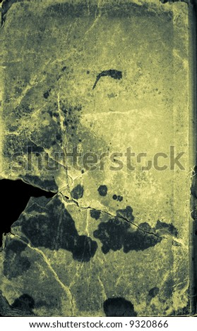 Green grunge cracked stained paper book cover with hole